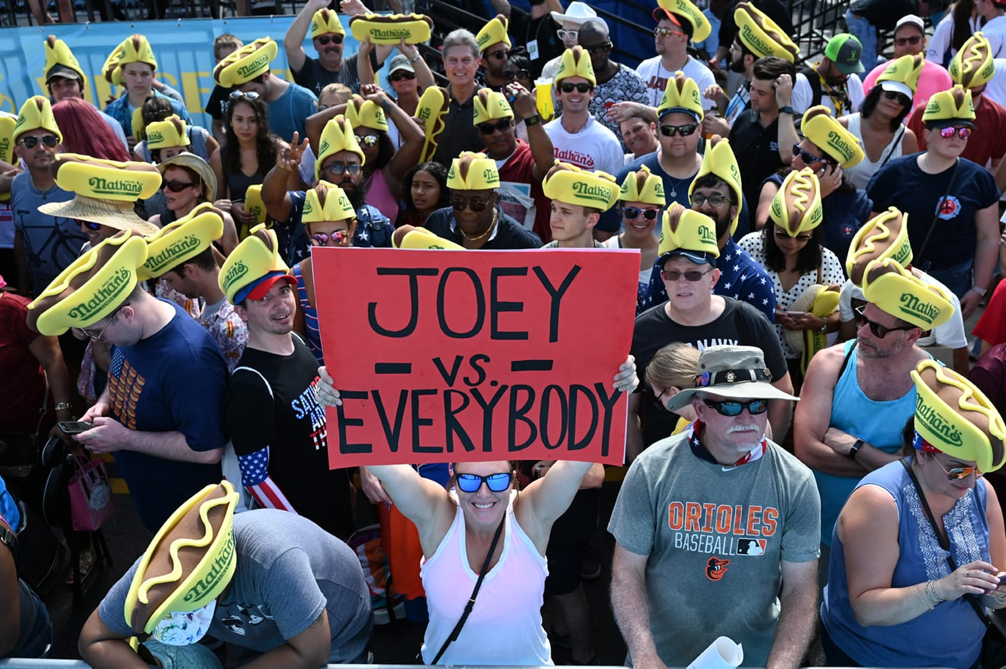 Woman holding 'Joey vs Everybody' sign